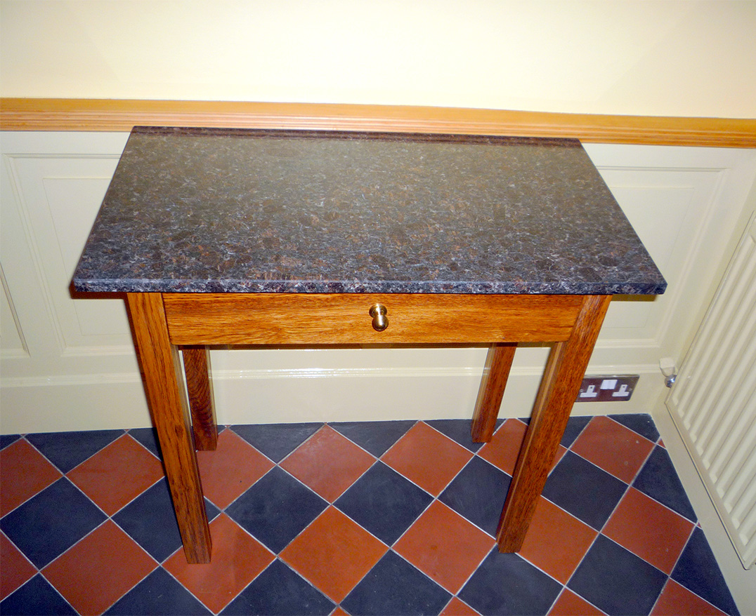 custom made console table in brown oak with granite top