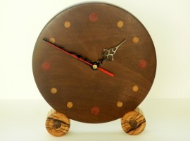 Handmade wooden clock in Afra wood with numerals in other woods