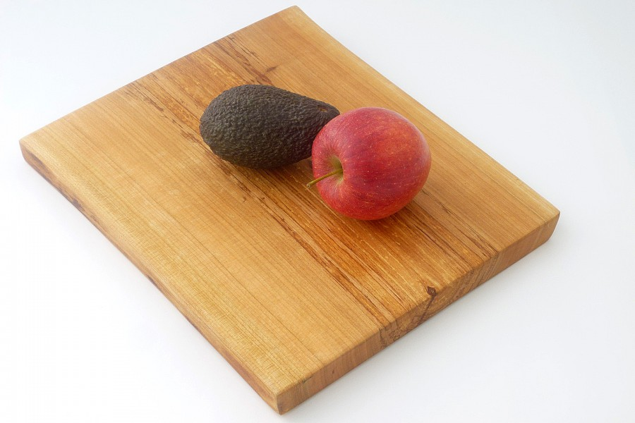 Handmade wooden pear shaped chopping board in English wild cherry