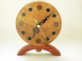 Handmade wooden clock in corrugata wood with numerals in various woods