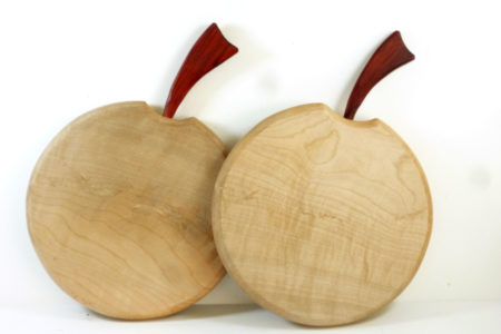 wooden apple shaped quilted sycamor chopping board with bloodwood stalk detail